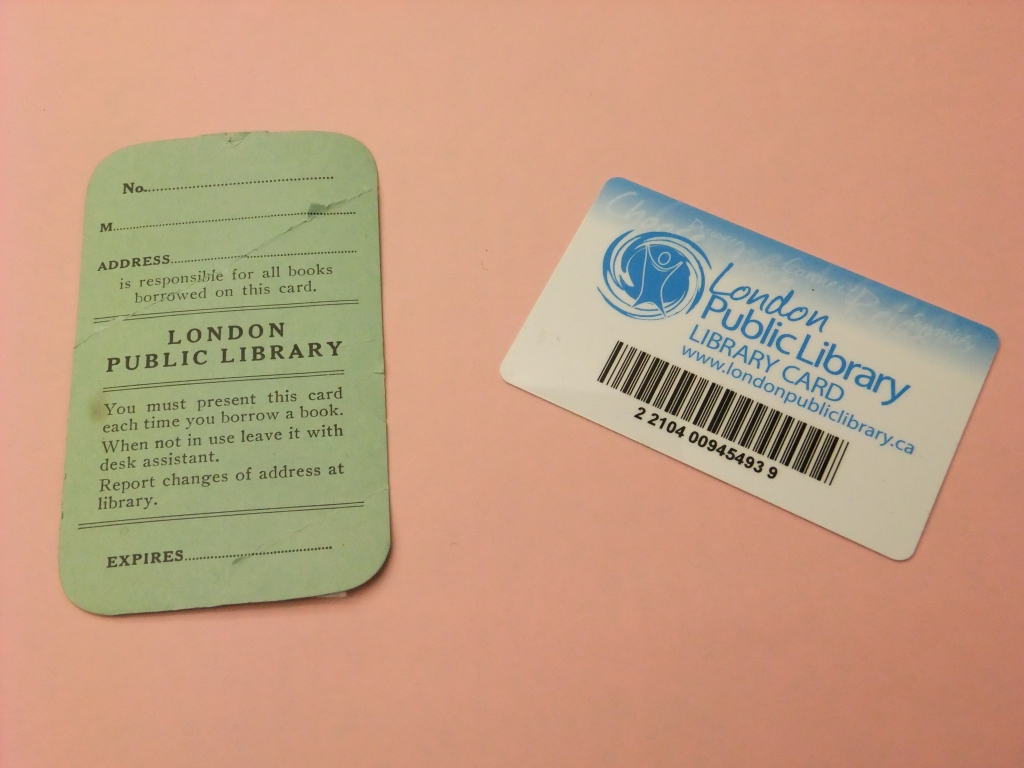 old paper library card on a desk