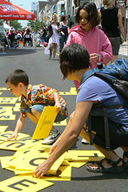 Kids playing with letters at car free day