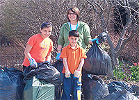 staff and friends with garbage bags outside at Beacock Branch Library