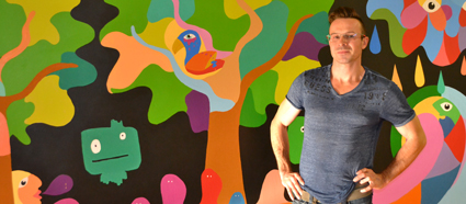Jeremy Jeresky in front of the community art project at Beacock.
