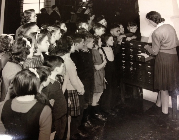 Photo of a group of children at a card catalogue