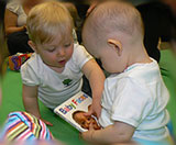 babies looking at books